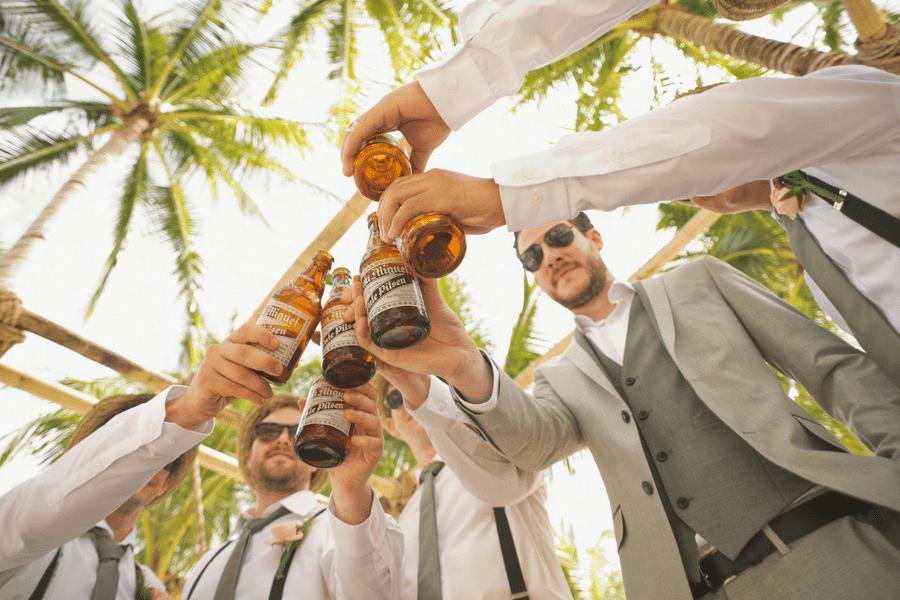 groom beach wedding