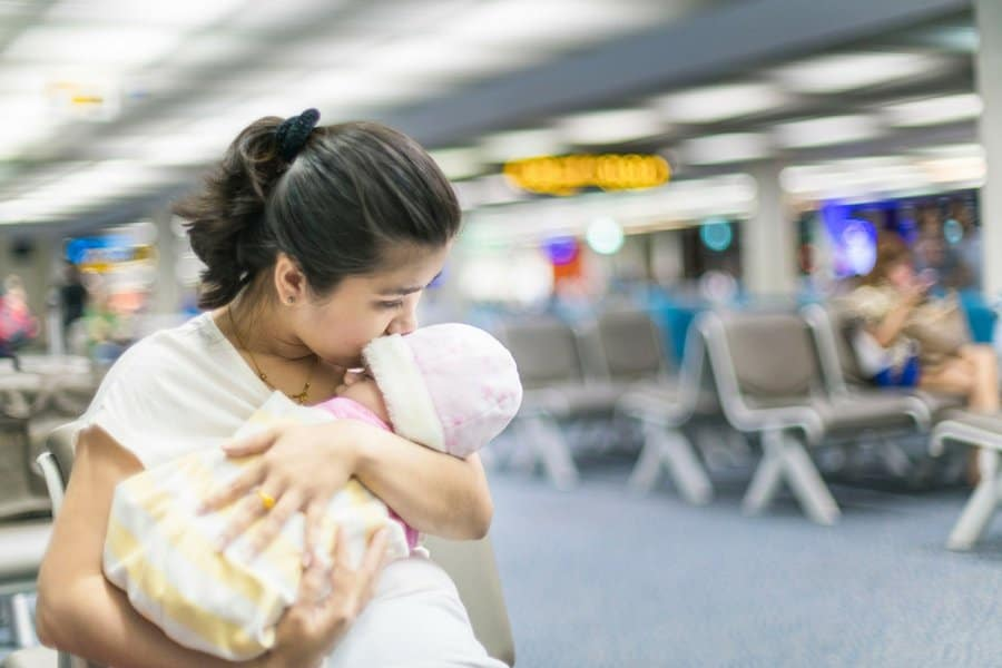 flying with baby prevent ear pain - 6 Secrets To Stress-Free Travel With Baby