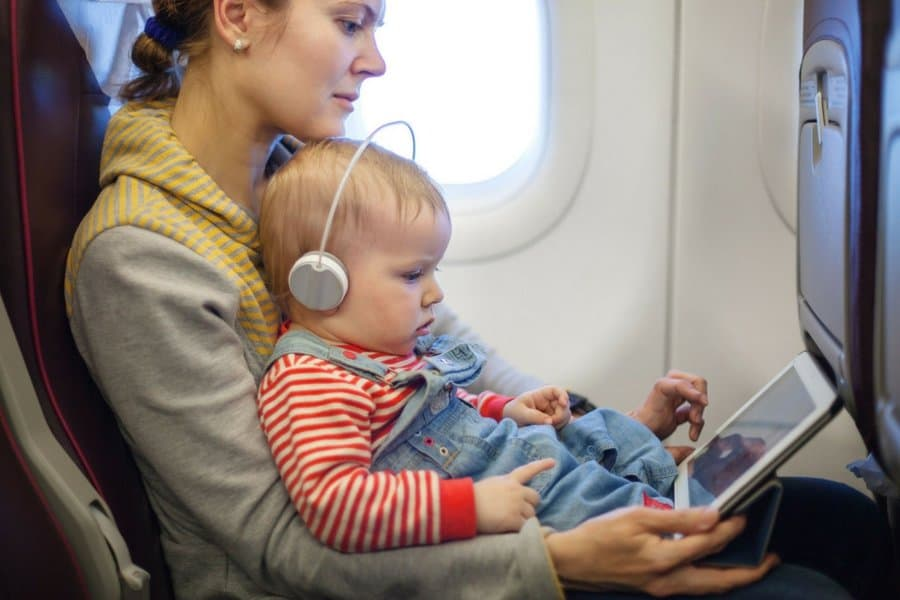flying with baby bring entertainment - 6 Secrets To Stress-Free Travel With Baby