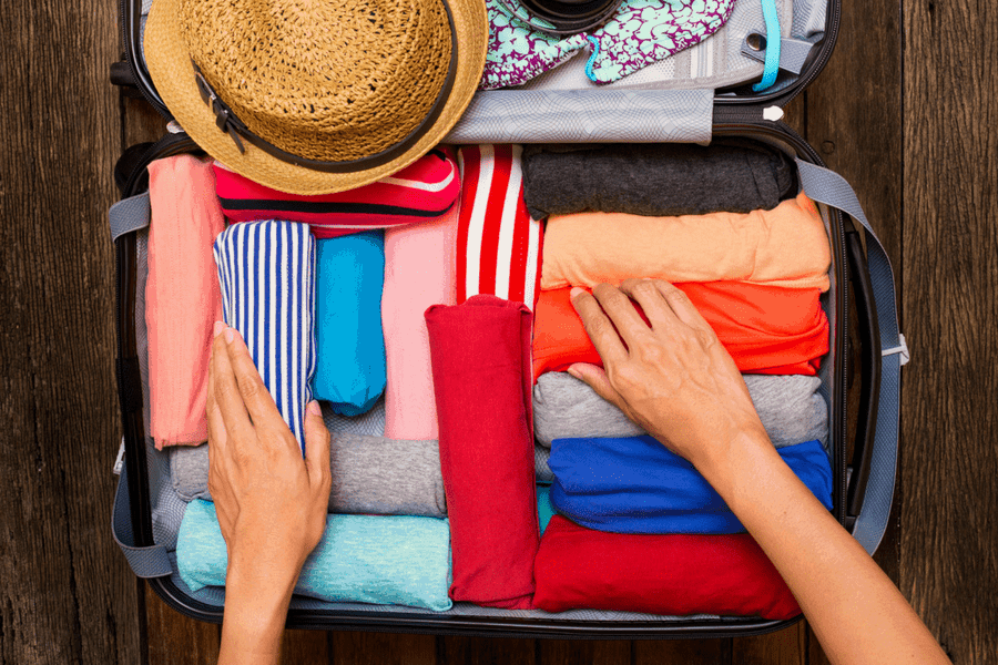 roll it up - 10 Packing and Traveling Tips Every Woman Should Know