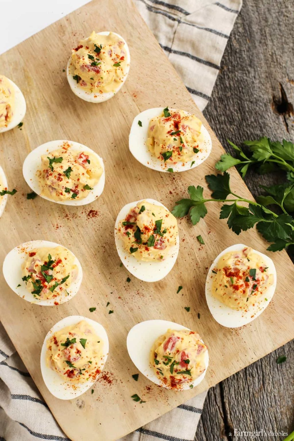 a farmgirls dabbles smoky tomato deviled eggs 1024x1536 - 10 Easy Real Food Snacks – No Baking Required!