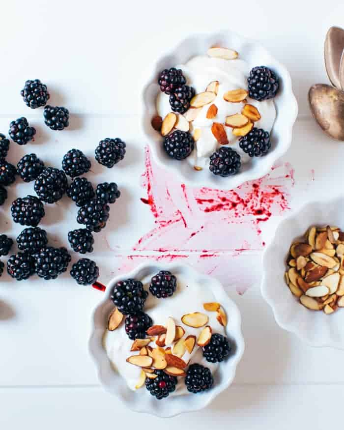a couple cooks berries and yogurt whipped cream - 10 Easy Real Food Snacks – No Baking Required!